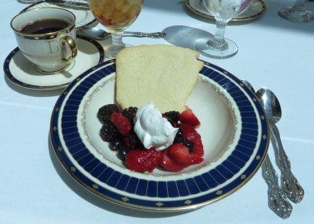 Coffee and dessert on the Governor's Mansion china: a sugar-cookie in the shape of Arkansas and mixed berries.