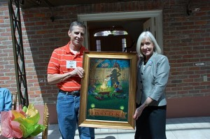 Illustrator Rich Davis donate artwork to Mrs. Ginger Beebe, First Lady of Arkansas