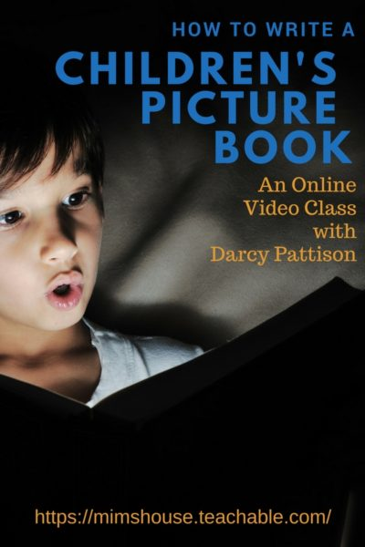 Boy in the dark looking at book. Write a Picture Book Course by Darcy Pattison | Mims House